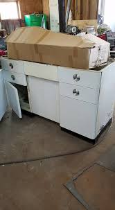 how to redo metal kitchen cabinets metal kitchen cabinets sanded painted white and clear