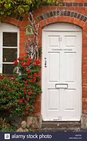 White Front Door White Front Door Of A Red Brick House Known As Teacher U0027s Cottge In