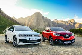 renault hatchback models comparative review hyundai tucson vs kia sportage vs renault