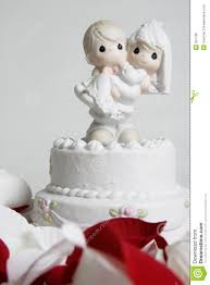 wedding cake ornament ornament of groom carrying on top of wedding cake stock