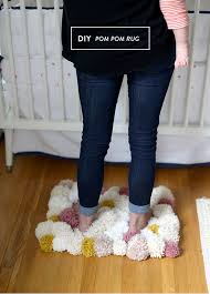 How To Make A Wool Rug With A Hook Diy Easy Pom Pom Rug Say Yes