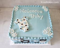 mod onesie baby shower cake and blue candy apples rose bakes