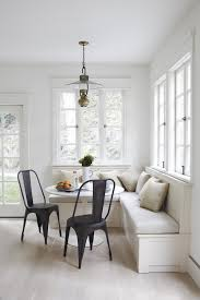 white kitchen banquette beige cushions black dining chairs small