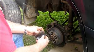 2002 green subaru forester installing rear brake pads on 2004 subaru forester youtube