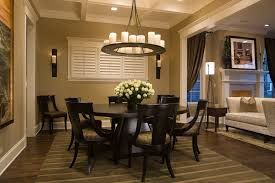 good looking expandable round dining table in dining room