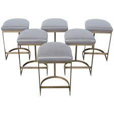milo baughman burnished brass bar stools in grey leather from a