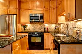 interior design exciting kraftmaid kitchen cabinets with stone appealing kraftmaid kitchen cabinets with marble backsplash and black granite countertop for traditional kitchen design