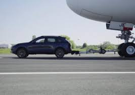 porsche cayenne towing cayenne breaks record for towing s largest passenger