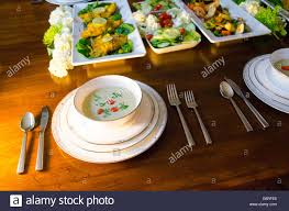buffet style dinner party in an elegant setting with soup fish