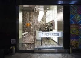 floor to wall books dizzying sideways cafe design in nyc urbanist