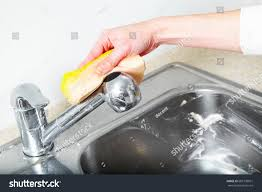 woman hand doing chores kitchen home stock photo 682738051
