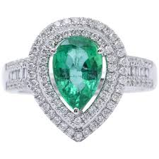 emerald engagement ring pear shape emerald gold halo cocktail engagement ring for