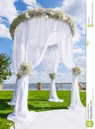arch for wedding wedding setting on a green lawn white wedding arch stock photo