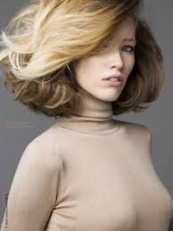 volume bob hair 70s bob hairstyle with teasing volume and a turtleneck