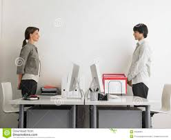 business people standing at computer desks stock photos image