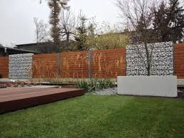 image result for gabion and wood fence mixed sound barrier ideas