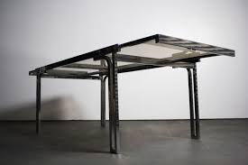 glass and chrome dining table smoked glass chrome expandable dining table in the manner of milo