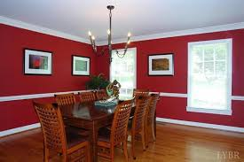traditional dining room with crown molding hardwood floors in