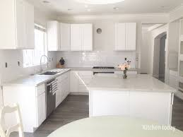 white shaker kitchen cabinets with gray quartz countertops white shaker cabinets still missing pulls glass doors