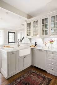 White And Gray Kitchen Cabinets by Exquisite Gray Kitchen Features A Gray Trellis Rug Placed In Front
