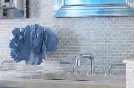blue beach themed bathroom with blue iridescent glass tile