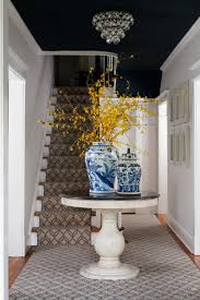 Entry Table Decor by A Round Foyer Table Topped With Pottery And A Gorgeous Yellow
