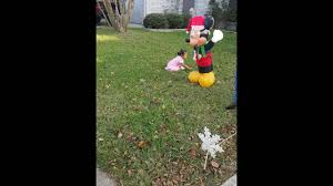 Grinch Blow Up Yard Decoration by Ella Beating Up Mickey Mouse Christmas Blow Up Youtube