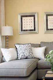 gray sofa yellow walls shelly holida this is kind of