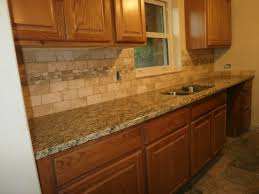 stone kitchen backsplash with oak cabinets herringbone tile solid