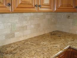 tumbled marble backsplash is beautiful in a subway tile pattern