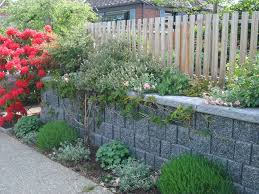 Retaining Wall Garden Bed by Contemporary Landscape And Yard With Exterior Stone Floors By