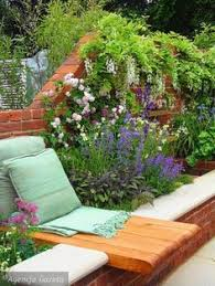 Fragrant Patio Plants - patio plantings of fragrant herbs and flower garden next to brick