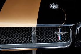 mustang grill emblems 1965 ford mustang grille emblem 3 photograph by reger