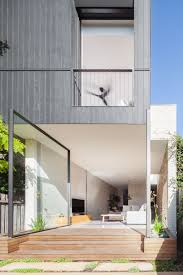 d house features large glass pivoting doors home design lover