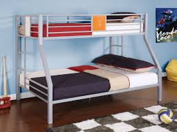 gray polished iron bunk bed using black bed linen and red blanket