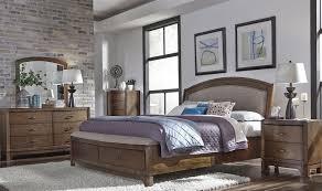 avalon bedroom set avalon iii pebble brown upholstered storage bedroom set from