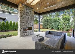 chic patio design with vaulted ceiling and stone fireplace u2014 stock