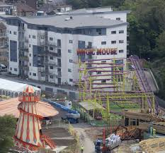 families furious after funfair builds roller coaster just a few
