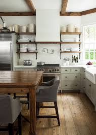 Kitchens With Green Cabinets by White Kitchen With Exposed Beams Open Shelves Farm Table Crocks