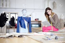 fashion designer fashion designer looking at designs on tablet computer in the