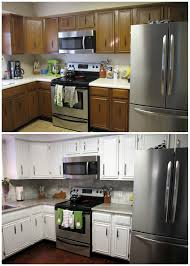 Refinishing White Kitchen Cabinets Remodelaholic Diy Refinished And Painted Cabinet Reviews