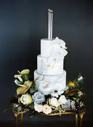 picture of light grey marble wedding cake with white orchids