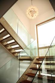 60 best oak staircases bespoke staircases images on pinterest trendy coastal house equipped with indoor swimming pool stunning contemporary wooden staircase design with glass balustrade unique bulb pe