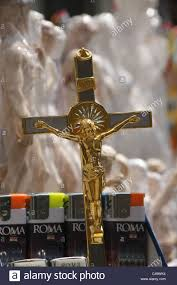 crucifix for sale crucifix for sale on gift stand stall in rome italy stock photo