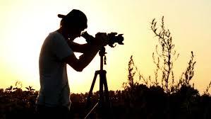 photographer and videographer photographer videographer shoots at dusk viewfinder stock