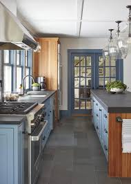 kitchen cabinets with gray floors blue kitchen cabinets with gray floor tiles cottage kitchen