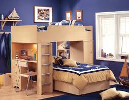 bedroom cream wooden bunk bed connected with desk also storage combined with blue bedding sheet