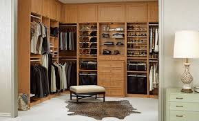 how to design a walk in closet with brown color theme ideas