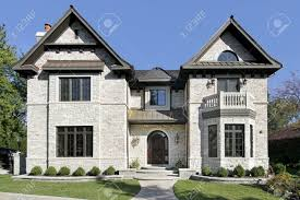 front view of luxury stone home with balcony stock photo picture