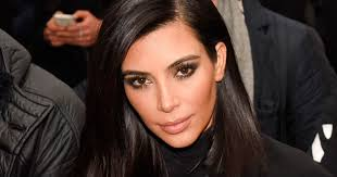 kim kardashian sues website alleging paris robbery fake